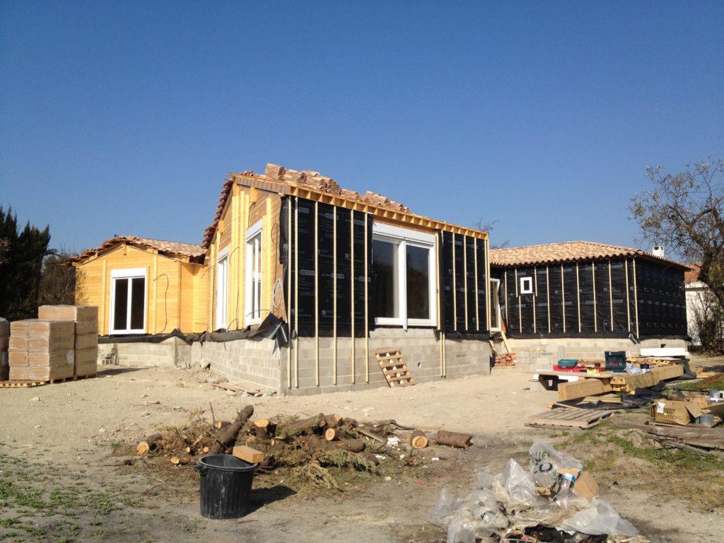 reconstruction d'une maison en bois massif